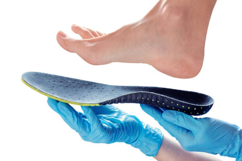 orthopedic insole in the hands